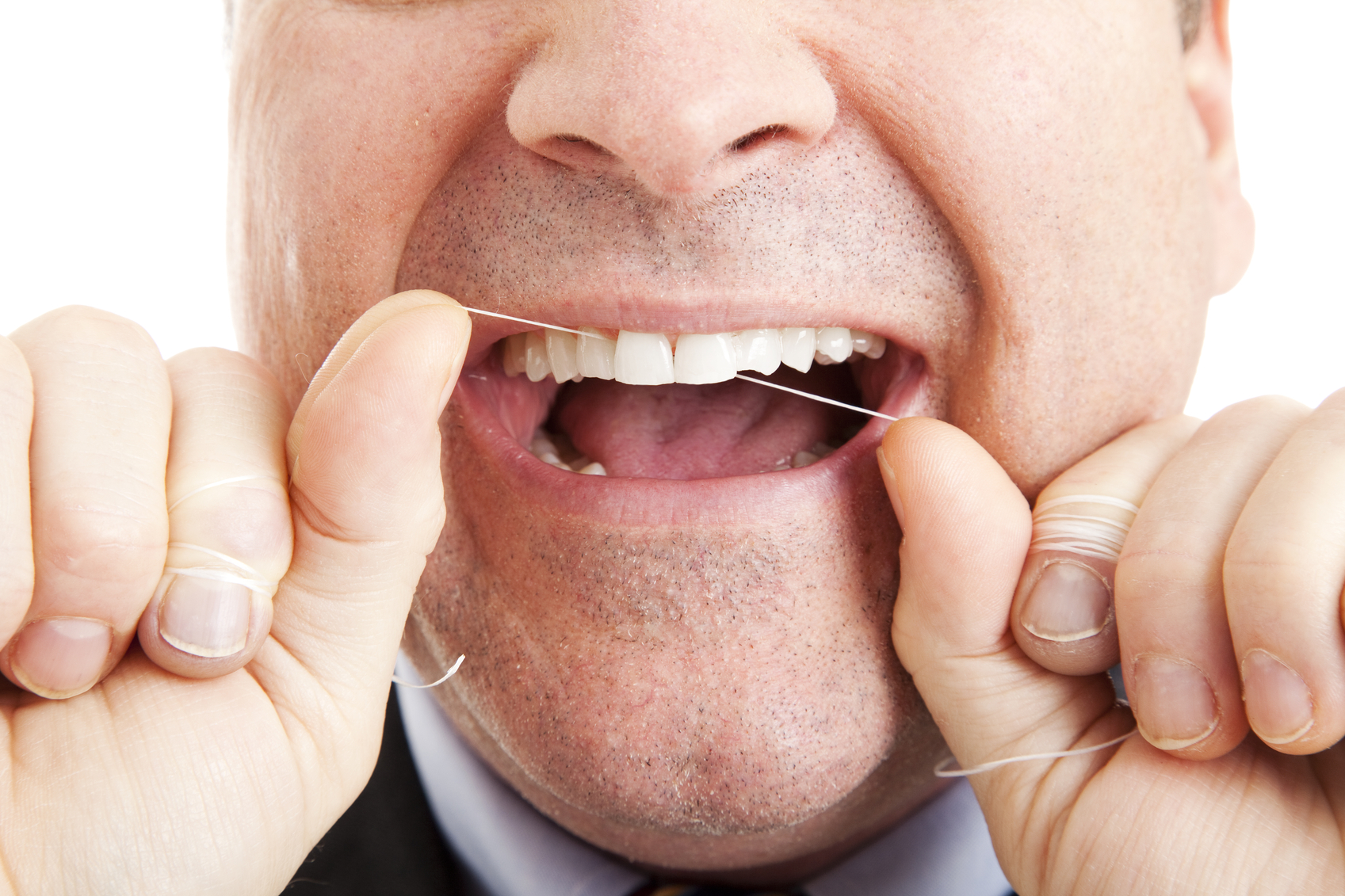 Flossing urged, despite weak evidence it works