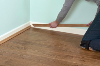 Laying Laminate Flooring how to install laminate flooring diy flooring homeimprovement laminateflooring at Make Sure To Glue The Skirting To The Wall And Not The Floor