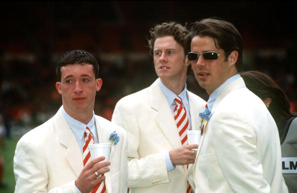 Sport. Football. pic: 11th May 1996.FA. Cup Final at Wembley. Liverpool 0. v Manchester United 1. Liverpool's, left-right, Robbie Fowler, Steve MacManaman and Jamie Redknapp smart in their matching white suits.