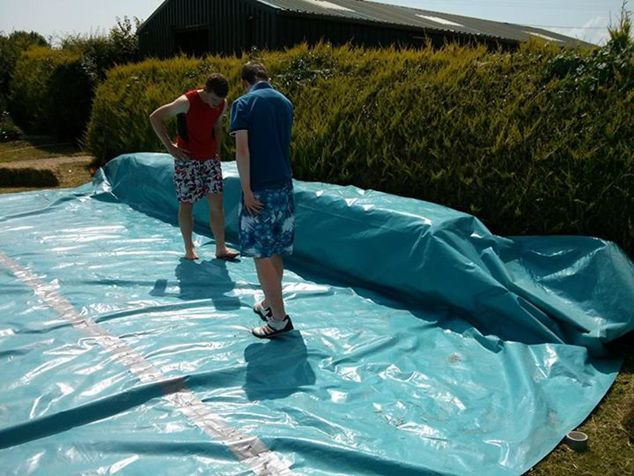 Pics irish lads build their own swimming pool using bales - How long after pool shock before swim ...