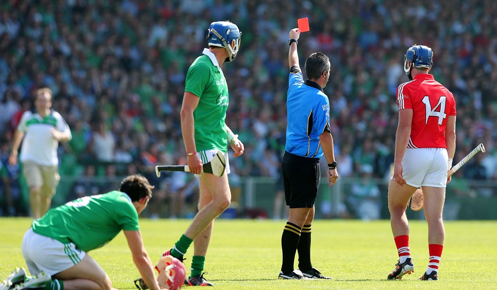 Patrick Horgan is shown a red card by referee James McGrath after a foul on Paudie O'Brien 14/7/2013