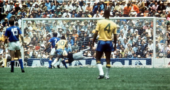 World Cup Final 1970 Mexico City, Mexico. 21st June, 1970. Brazil 4 v Italy 1. Brazil's Pele scores the opening goal of the World Cup Final past Italien goalkeeper Enrico Albertosi in the nineteenth minute watched by captain Carlos Alberto.