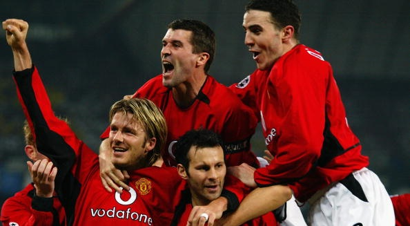 Manchester United players David Beckham, Roy Keane and John O'Shea celebrate team-mate Ryan Giggs superb second goal