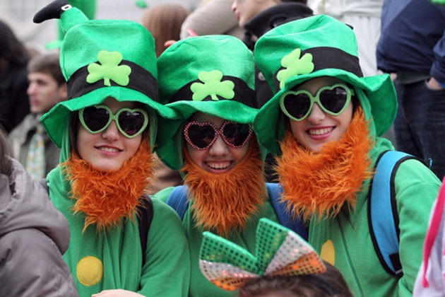 Spectators dressed as leprechauns attend St Patrick's Day parade in Dublin on March 17, 2014. More than 100 parades are being held across Ireland to mark St Patrick's Day, the feast day of the patron saint of Ireland, with up to 650,000 spectators expected to attend the parade in Dublin. AFP PHOTO/ PETER MUHLY        (Photo credit should read PETER MUHLY/AFP/Getty Images)
