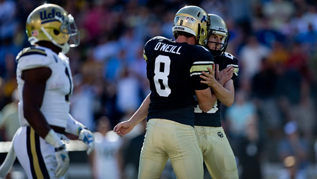 BOULDER, CO - OCTOBER 25:  Place kicker Will Oliver #28 of the Colorado Buffaloes is congratulated by holder Darragh O'Neill #8 after kicking the game typing field goal during the fourth quarter against the UCLA Bruins at Folsom Field on October 25, 2014 in Boulder, Colorado. The Bruins defeated the Buffaloes 40-37 in double overtime. (Photo by Justin Edmonds/Getty Images)