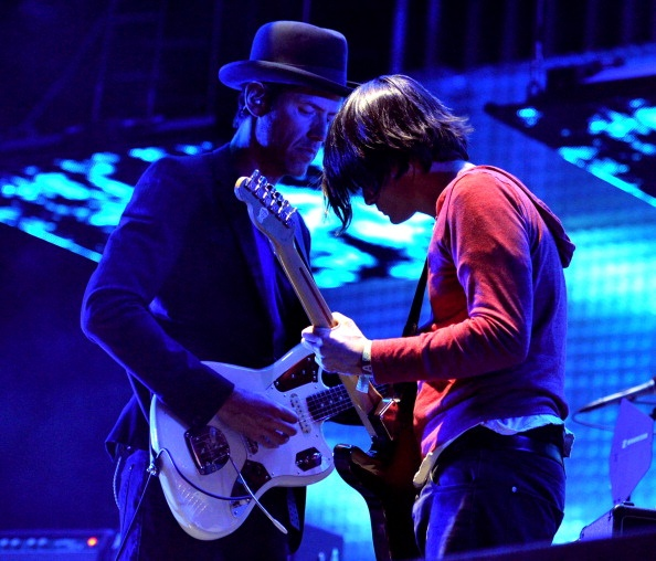 INDIO, CA - APRIL 14: Musicians Ed O'Brien (L) and Jonny Greenwood of Radiohead perform onstage during day 2 of the 2012 Coachella Valley Music & Arts Festival at the Empire Polo Field on April 14, 2012 in Indio, California. (Photo by Kevin Winter/Getty Images for Coachella)
