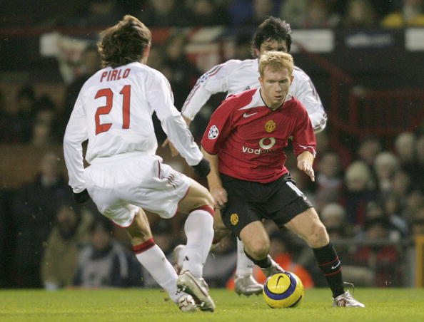 MANCHESTER, ENGLAND - FEBRUARY 23: Paul Scholes of Manchester United clashes with Andrea Pirlo and Gennaro Gattuso of AC Milan during the UEFA Champions League match between Manchester United and AC Milan at Old Trafford on February 23 2005 in Manchester, England. (Photo by Matthew Peters/Manchester United via Getty Images)