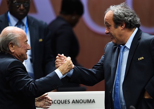 ZURICH, SWITZERLAND - MAY 29:  Joseph S. Blatter (L) is congratulated by UEFA President Michel Platini of France as he is re-elected as FIFA President after Presidential candidate H.R.H Prince Ali Bin Al Hussein of Jordan withdrew from the second vote during the 65th FIFA Congress at the Hallenstadion on May 29, 2015 in Zurich, Switzerland.  (Photo by Mike Hewitt - FIFA/FIFA via Getty Images)
