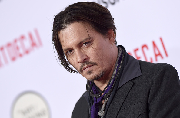 HOLLYWOOD, CA - JANUARY 21:  Actor Johnny Depp arrives at the Los Angeles premiere of 'Mortdecai' at TCL Chinese Theatre on January 21, 2015 in Hollywood, California.  (Photo by Axelle/Bauer-Griffin/FilmMagic)