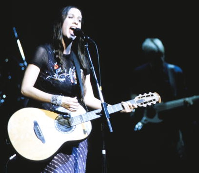 Alanis Morissette performing at the Warfield Theater in San Francisco CA on November 15th, 1995. Image By: Tim Mosenfelder/Getty Images