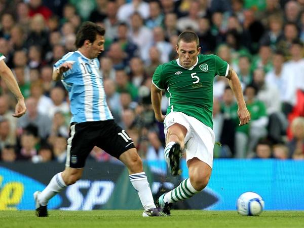 International Friendly 11/8/2010 Republic of Ireland vs Argentina Ireland's Richard Dunne and Lionel Messi of Argentina Mandatory Credit ©INPHO/Lorraine O'Sullvian *** Local Caption ***