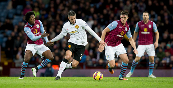 BIRMINGHAM, ENGLAND - DECEMBER 20: Ciaran Clark of Aston Villa is challenged by Robin van Persie of Manchester United during the Barclays Premier League match between Aston Villa and Manchester United at Villa Park on December 20, 2014 in Birmingham, England.  (Photo by Neville Williams/Aston Villa FC via Getty Images)