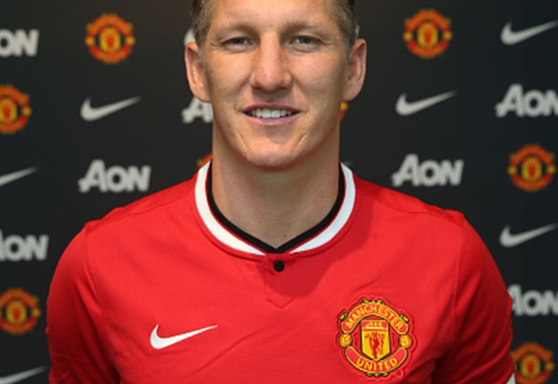 MANCHESTER, ENGLAND - JULY 13:  (EXCLUSIVE COVERAGE) (MINIMUM FEES APPLY - 150 GBP PRINT AND ON AIR & 75 GBP ONLINE OR LOCAL EQUIVALENT, PER IMAGE) Bastian Schweinsteiger of Manchester United poses after signing for the club at Aon Training Complex on July 13, 2015 in Manchester, England.  (Photo by John Peters/Man Utd via Getty Images)