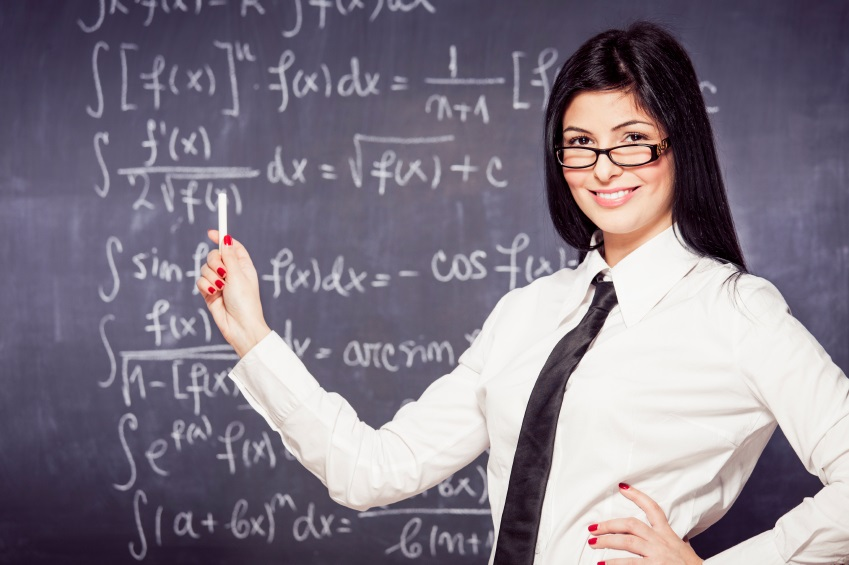 Beautiful math teacher standing in front of blackboard