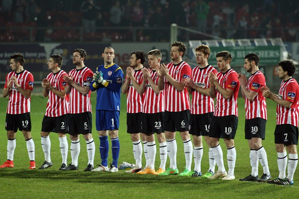SSE Airtricity League Premier Division, Brandywell Stadium, Derry 13/3/2015 Derry City vs Dundalk Derry City players during the one minute's applause in memory of legendary Derry photographer Larry Doherty Mandatory Credit ©INPHO/Presseye/Lorcan Doherty