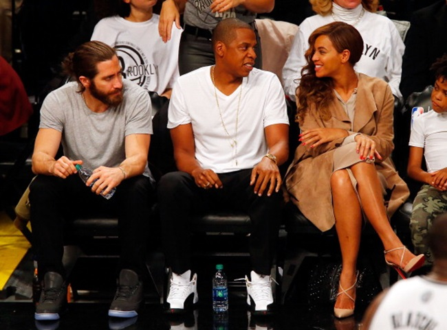 NEW YORK, NY - MAY 10: (NEW YORK DAILIES OUT) Actor Jake Gyllenhall and recording artists Jay-Z and Beyonce attend Game Three of the Eastern Conference Semifinals during the 2014 NBA Playoffs between the Brooklyn Nets and the Miami Heat at Barclays Center on May 10, 2014 in the Brooklyn borough of New York City. The Nets defeated the Heat 104-90 and trail the best of seven series two games to one. NOTE TO USER: User expressly acknowledges and agrees that, by downloading and/or using this Photograph, user is consenting to the terms and conditions of the Getty Images License Agreement. (Photo by Jim McIsaac/Getty Images)
