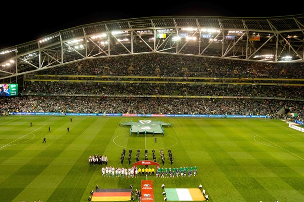 The teams line up for the National Anthems 8/10/2015