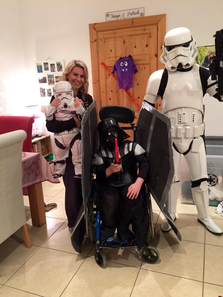 chair costume. introducing the star wars death chair/tie fighter, complete with oisín as a menacing darth vader. chair costume