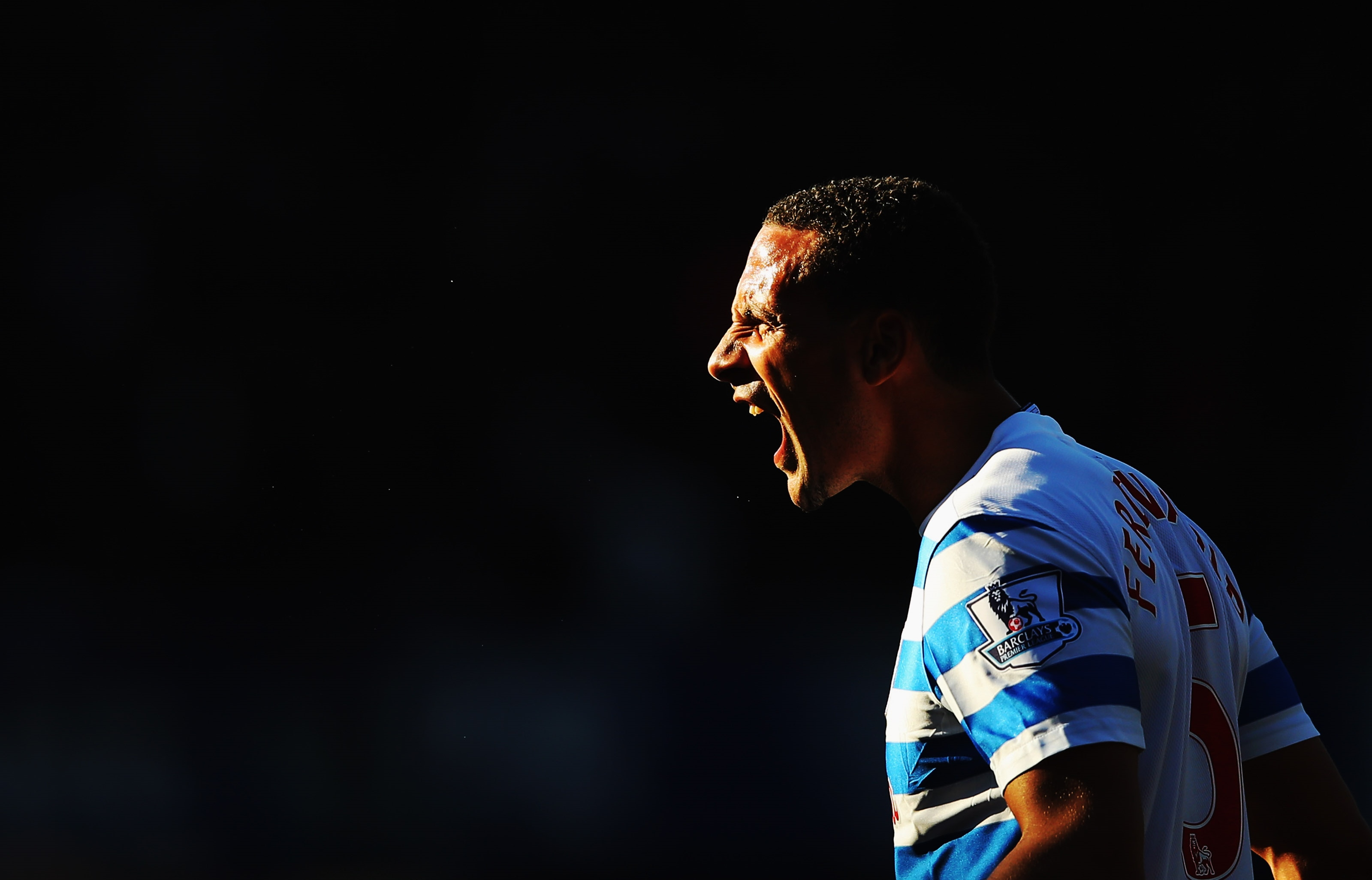 LONDON, ENGLAND - MARCH 07: Rio Ferdinand of QPR shouts during the Barclays Premier League match between Queens Park Rangers and Tottenham Hotspur at Loftus Road on March 7, 2015 in London, England. (Photo by Paul Gilham/Getty Images)