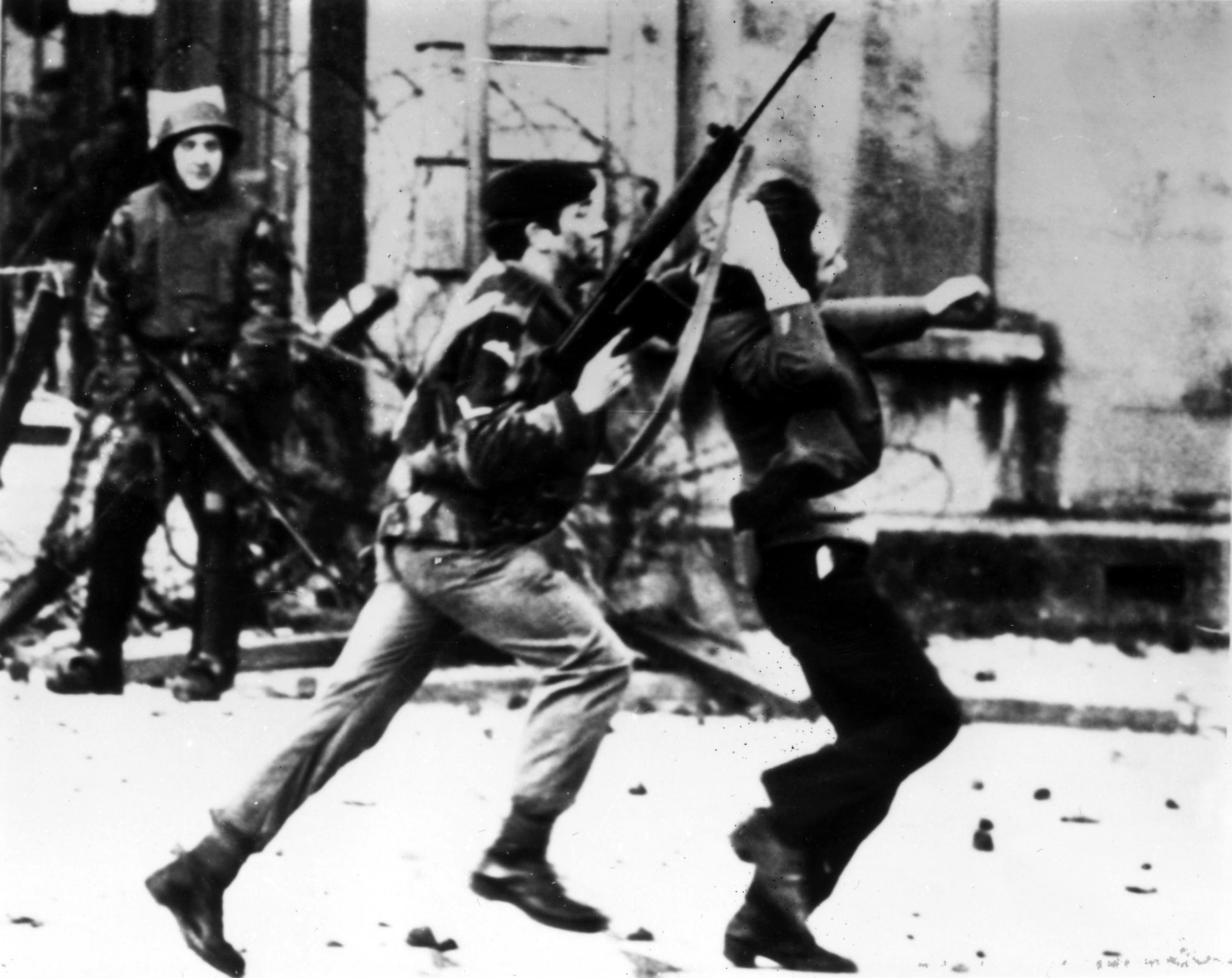"""400345 02: A British paratrooper takes a captured youth from the crowd on """"Bloody Sunday,"""" when British paratroopers opened fire on a civil rights march, killing 14 civilians, January 30, 1972 in Londonderry, Northern Ireland. Thousands of people are expected to take part in events to mark the 30th anniversary of """"Bloody Sunday"""" February 3, 2002 in Londonderry. (Photo by Getty Images)"""