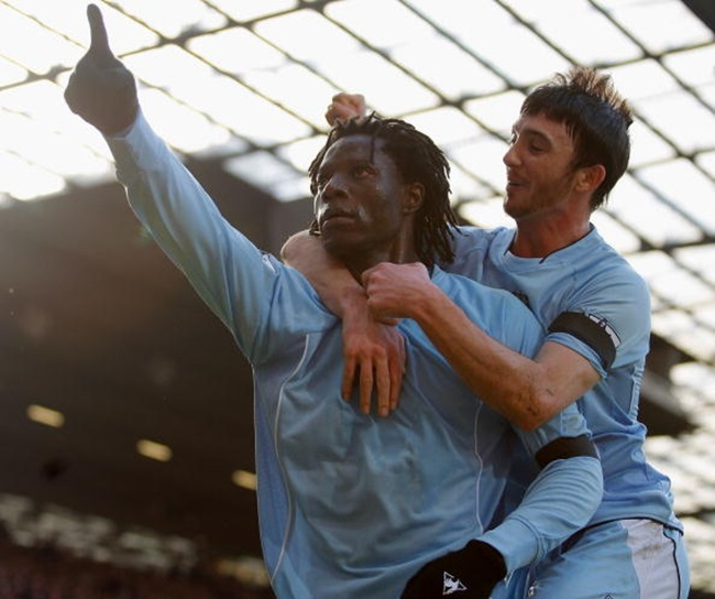 MANCHESTER, ENGLAND - FEBRUARY 10: Benjani of Manchester City celebrates scoring their second goal during the Barclays FA Premier League match between Manchester United and Manchester City at Old Trafford on February 10 2008, in Manchester, England. (Photo by Simon Bellis/Manchester United via Getty Images)