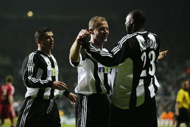 NEWCASTLE - FEBRUARY 26: Alan Shearer of Newcastle United celebrates scoring the second goal with team-mate Shola Ameobi during the UEFA Champions League Second Phase Group A match between Newcastle United and Bayer Leverkusen held on February 26, 2003 at St James Park, in Newcastle, England. Newcastle United won the match 3-1. (Photo by Clive Brunskill/Getty Images)