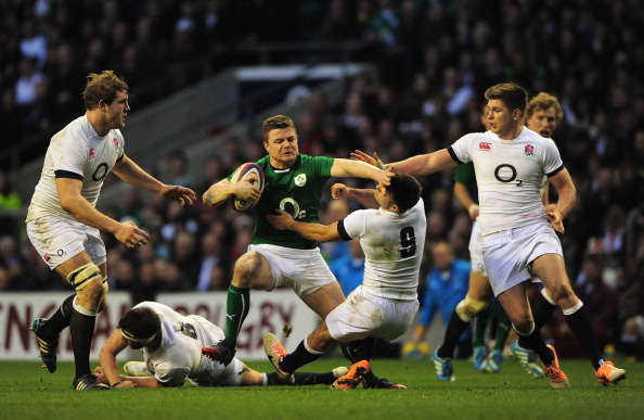 LONDON, ENGLAND - FEBRUARY 22: Brian O'Driscoll of Ireland hands off Danny Care of England during the RBS Six Nations match between England and Ireland at Twickenham Stadium on February 22, 2014 in London, England. (Photo by Shaun Botterill/Getty Images)
