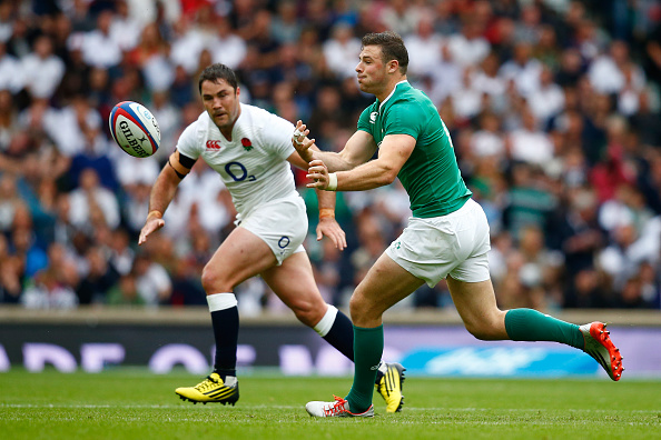LONDON, ENGLAND - SEPTEMBER 05: Robbie Henshaw of Ireland passes the ball during the QBE International match between England and Ireland at Twickenham Stadium on September 5, 2015 in London, England. (Photo by Mike Hewitt/Getty Images)