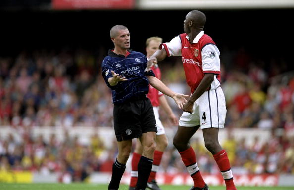 22 Aug 1999: Roy Keane of Manchester United clashes with Patrick Vieira of Arsenal during the FA Carling Premiership match against Arsenal played at Highbury in London, England. The match finished in a 2-1 win to Manchester United. Mandatory Credit:Clive Brunskill /Allsport