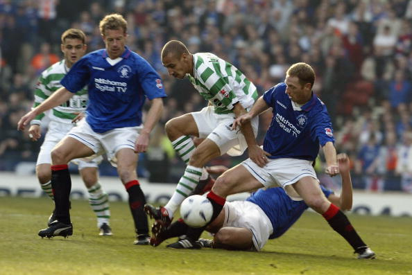 GLASGOW - MARCH 16: Henrik Larsson of Celtic is challenged by Craig Moore and Bert Konterman of Rangers during the CIS Insurance Cup Final match between Celtic and Glasgow Rangers held on March 16, 2003 at Hampden Park in Glasgow. Glasgow Rangers won the match 2-1. (Photo by David Cannon/Getty Images)