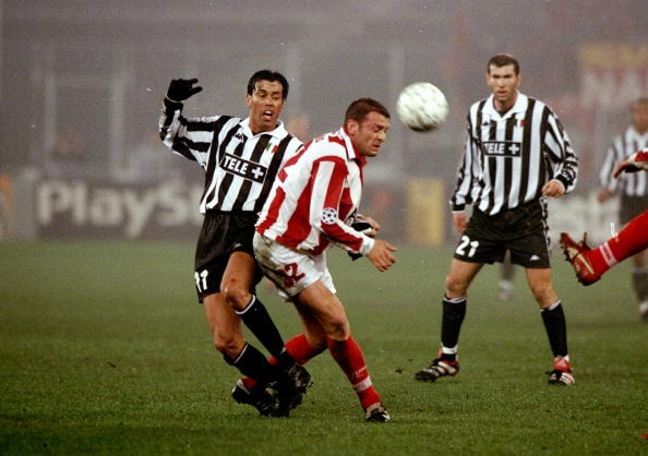 3 Mar 1999: Daniel Fonseca of Juventus clashes with Georgios Anatolakis of Olympiakos in the UEFA Champions League quarter-final first leg match at the Stadio Delle Alpi in Turin, Italy. Juventus won 2-1. Mandatory Credit: Stu Forster /Allsport