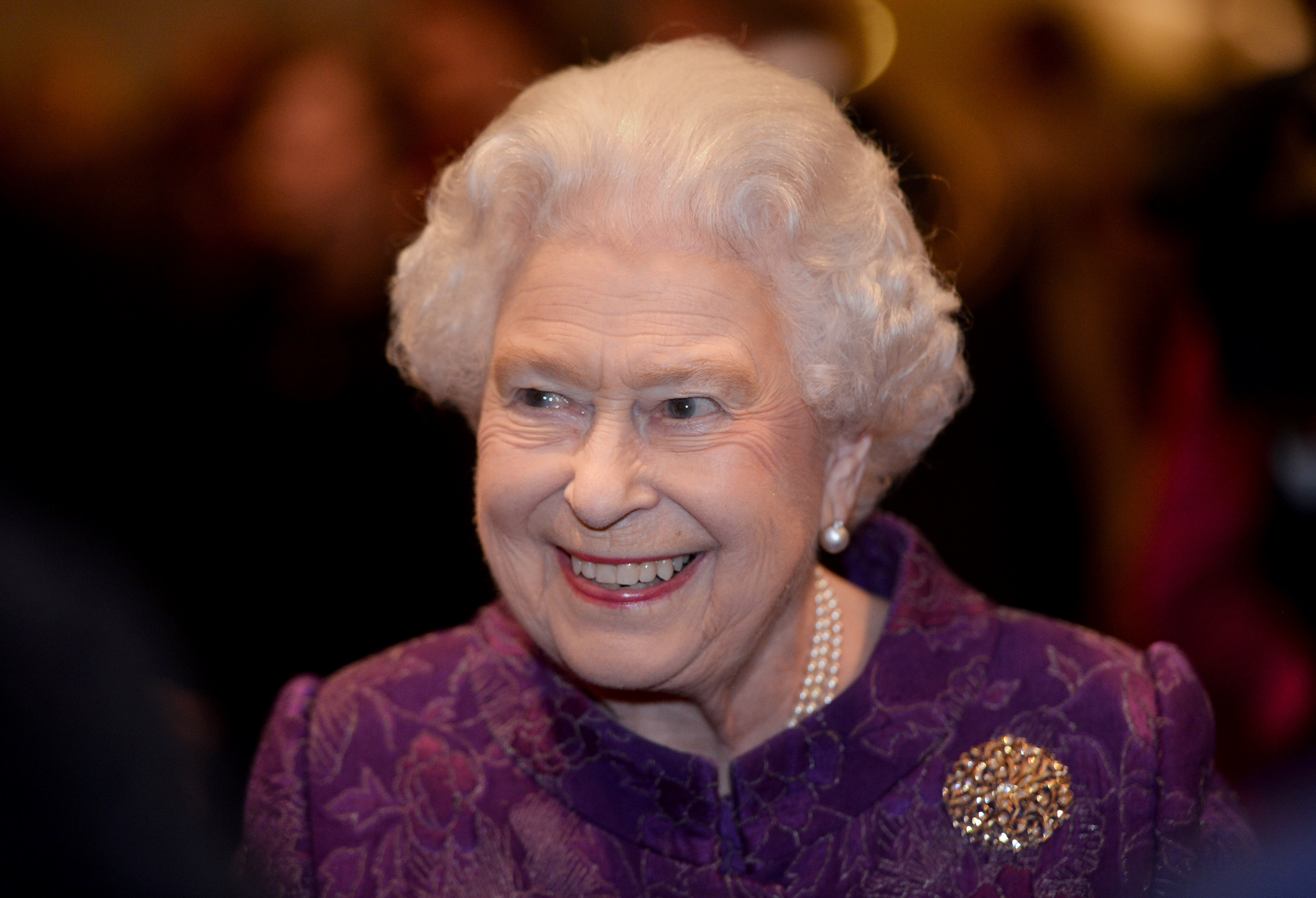 LONDON, UNITED KINGDOM - MARCH 16: Queen Elizabeth II meets guests during a reception for the High Commissioners' Banquet to mark Commonwealth Week at the Guildhall on March 16, 2016 in London, United Kingdom. (Photo by Anthony Devlin - WPA Pool/Getty Images)