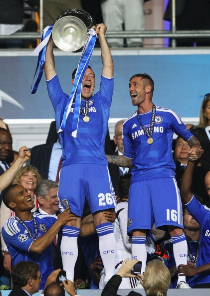 MUNICH, GERMANY - MAY 19: John Terry of Chelsea lifts the trophy after their victory in the UEFA Champions League Final between FC Bayern Muenchen and Chelsea at the Fussball Arena München on May 19, 2012 in Munich, Germany. (Photo by Alex Livesey/Getty Images)
