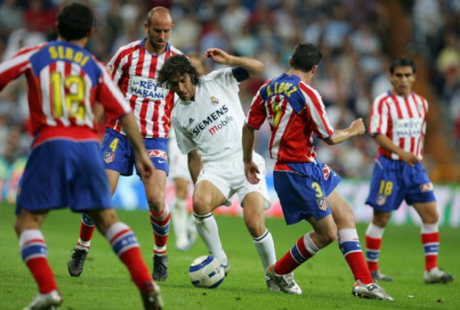 MADRID, SPAIN - MAY 21: Real's Raul Gonzalez dribbles the ball through the Atletico defense during a La Liga match between Real Madrid and Atletico Madrid at the Santiago Bernabeu stadium on May 21, 2005 in Madrid, Spain. (Photo by Denis Doyle/Getty Images)