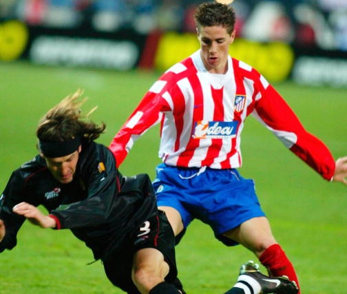 MADRID - FEBRUARY 16: Fernando Torres Sanz of Atletico brings down Miguel Soler of Mallorca during the La Liga match between Atletico Madrid and Real Mallorca played at the Vicente Calderon Stadium on February 16, 2003 in Madrid. (Photo by Firo Foto/Getty Images)