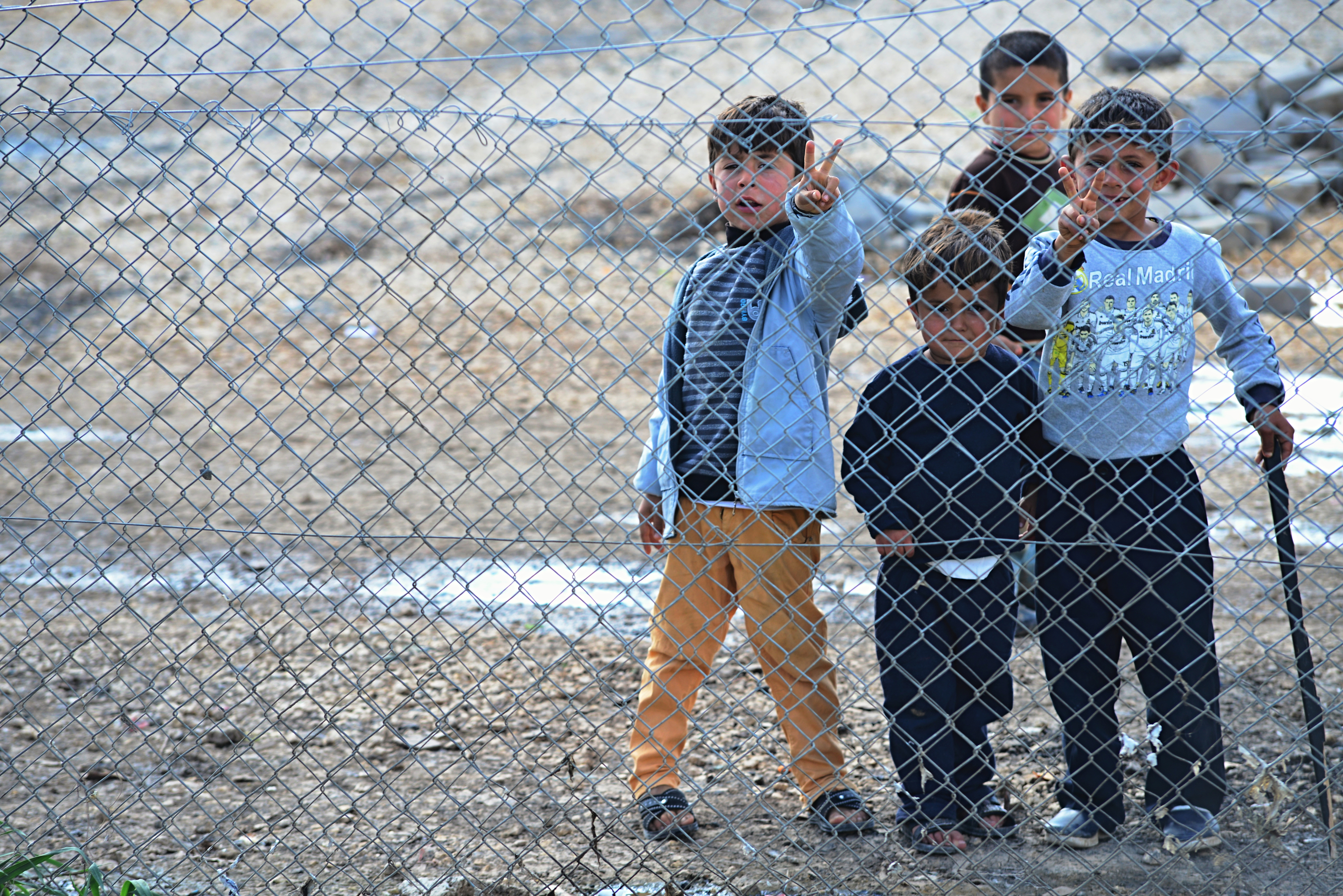 Suruc, Turkey - March 31, 2015: Syrian people in refugee camp in Suruc. These people are refugees from Kobane and escaped because of Islamic state attack.