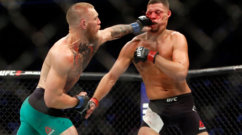 LAS VEGAS, NV - AUGUST 20: Conor McGregor (L) hits Nate Diaz with a left during their welterweight rematch at the UFC 202 event at T-Mobile Arena on August 20, 2016 in Las Vegas, Nevada. (Photo by Steve Marcus/Getty Images)