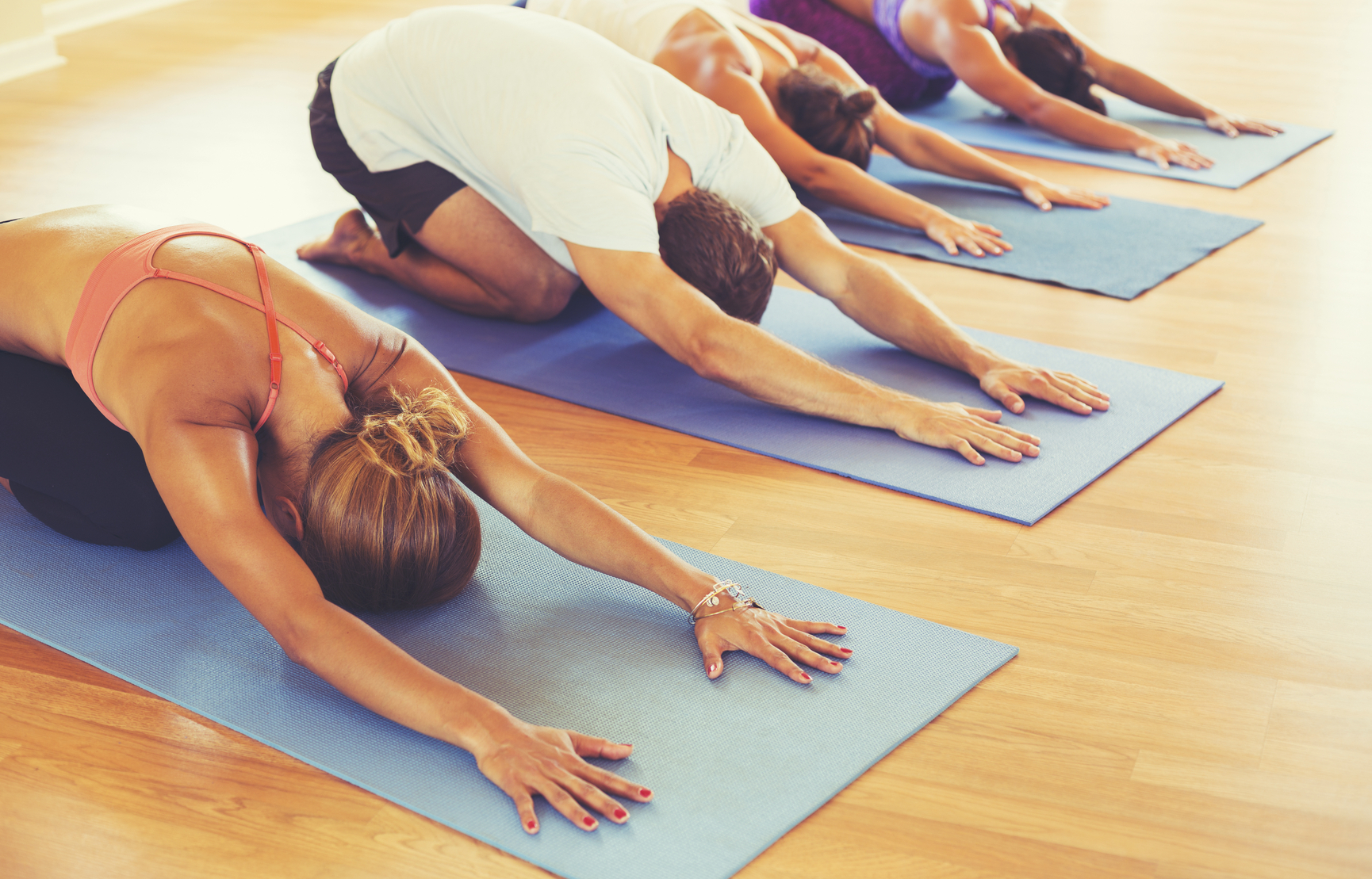 Yoga Class, Group of People Relaxing and Doing Yoga. Childs Pose. Wellness and Healthy Lifestyle.