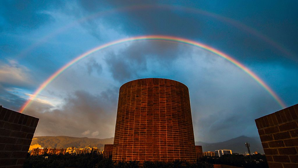 TOPSHOT - A rainbow seen during sunset in Bogota on June 3, 2016. / AFP / Luis Acosta (Photo credit should read LUIS ACOSTA/AFP/Getty Images)