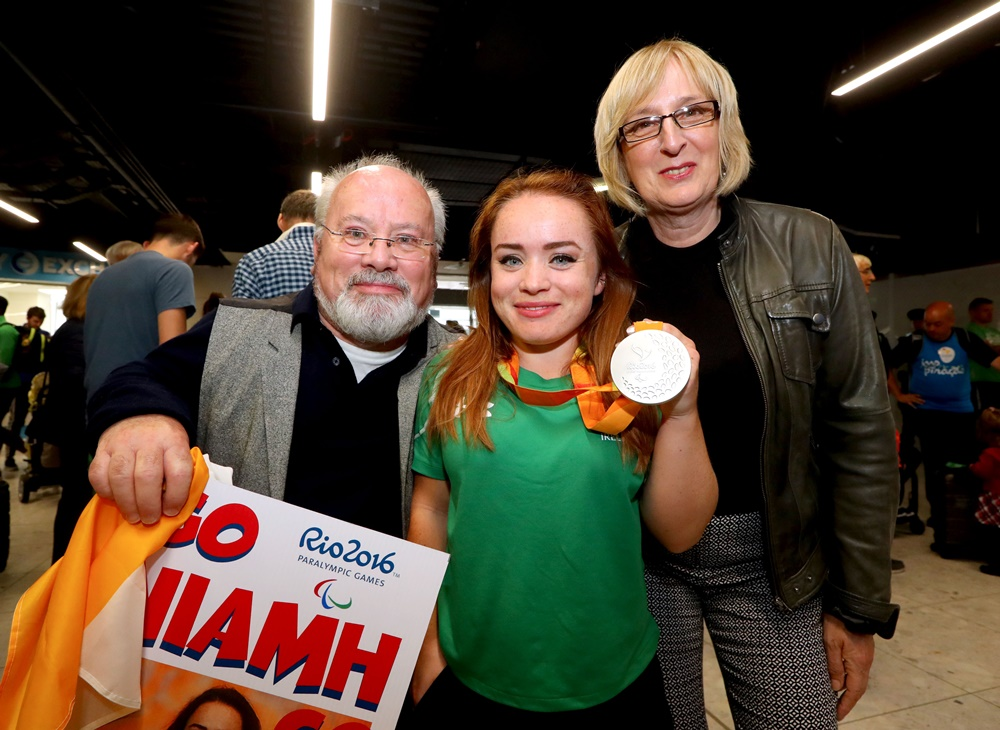 Team Ireland Paralympics Homecoming, Dublin Airport 21/9/2016 Discuss Silver Medalist Niamh McCarthy with her parents Flor and Caroline McCarthy Mandatory Credit ©INPHO/James Crombie