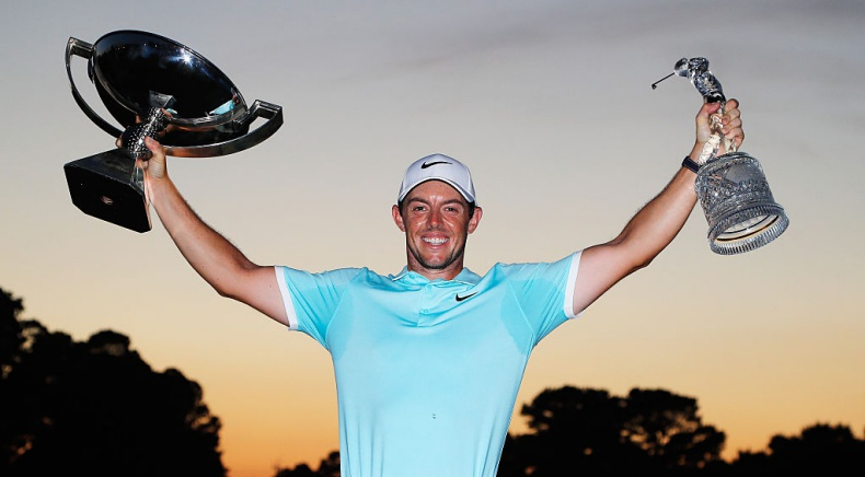 ATLANTA, GA - SEPTEMBER 25: Rory McIlroy of Northern Ireland poses with the FedExCup and TOUR Championship trophies after his victory over Ryan Moore with a birdie on the fourth extra hole during the TOUR Championship at East Lake Golf Club on September 25, 2016 in Atlanta, Georgia. (Photo by Kevin C. Cox/Getty Images)
