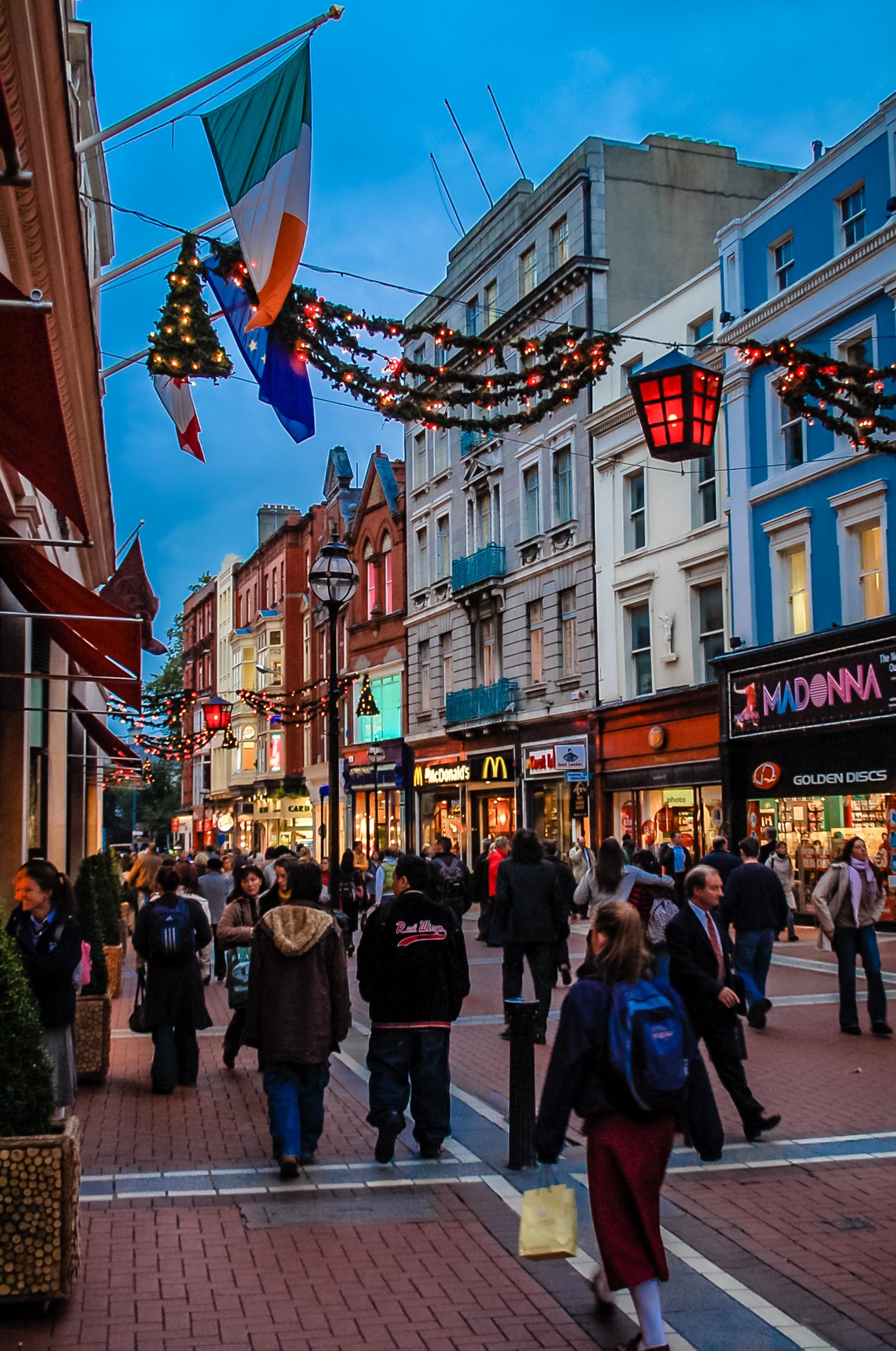 Dublin, Ireland - November 15, 2005: People wander along Grafton Street in Dublin, Ireland. Grafton Street is the main pedestrian street in Dublin and is full of shops, pubs and restaurants.